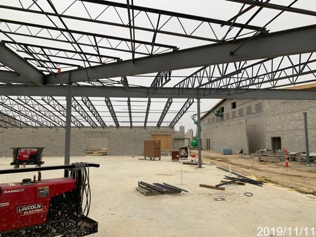 New building construction with structural steel and roof being added