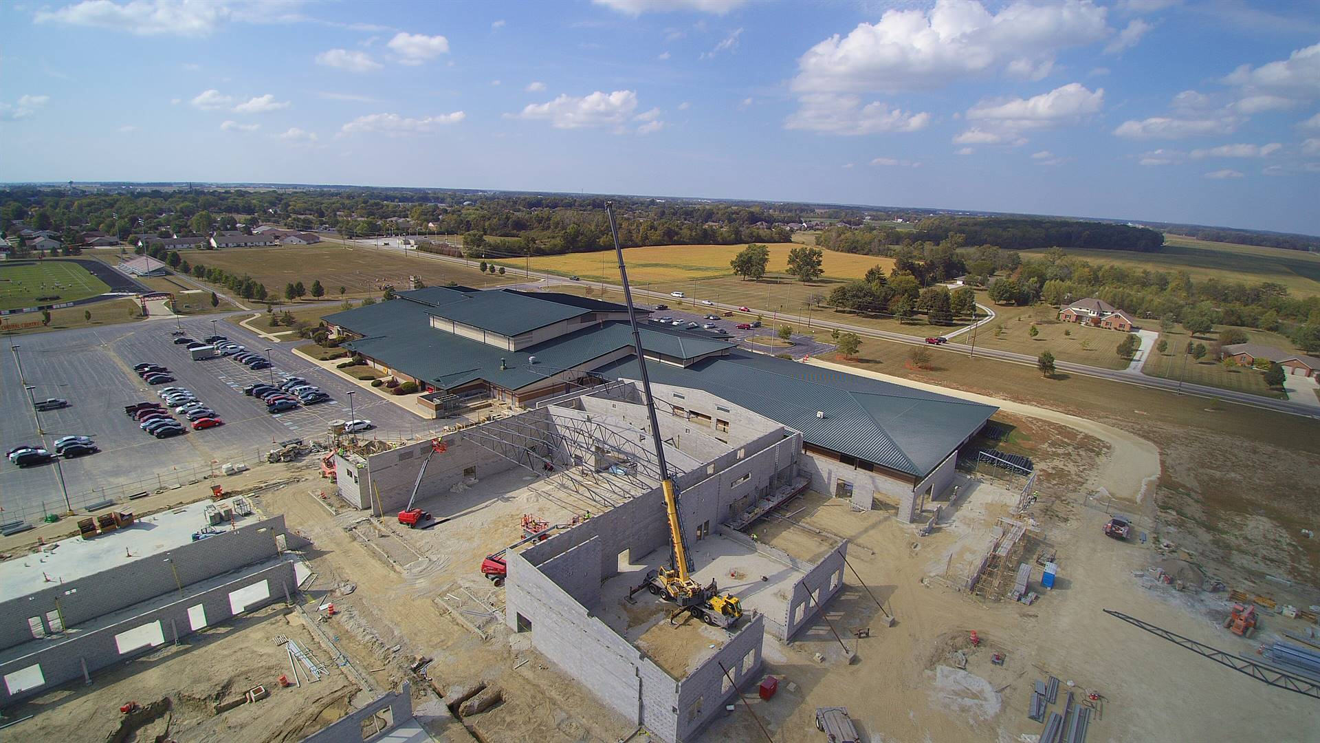 Aerial photo of crane setting steel roof truss