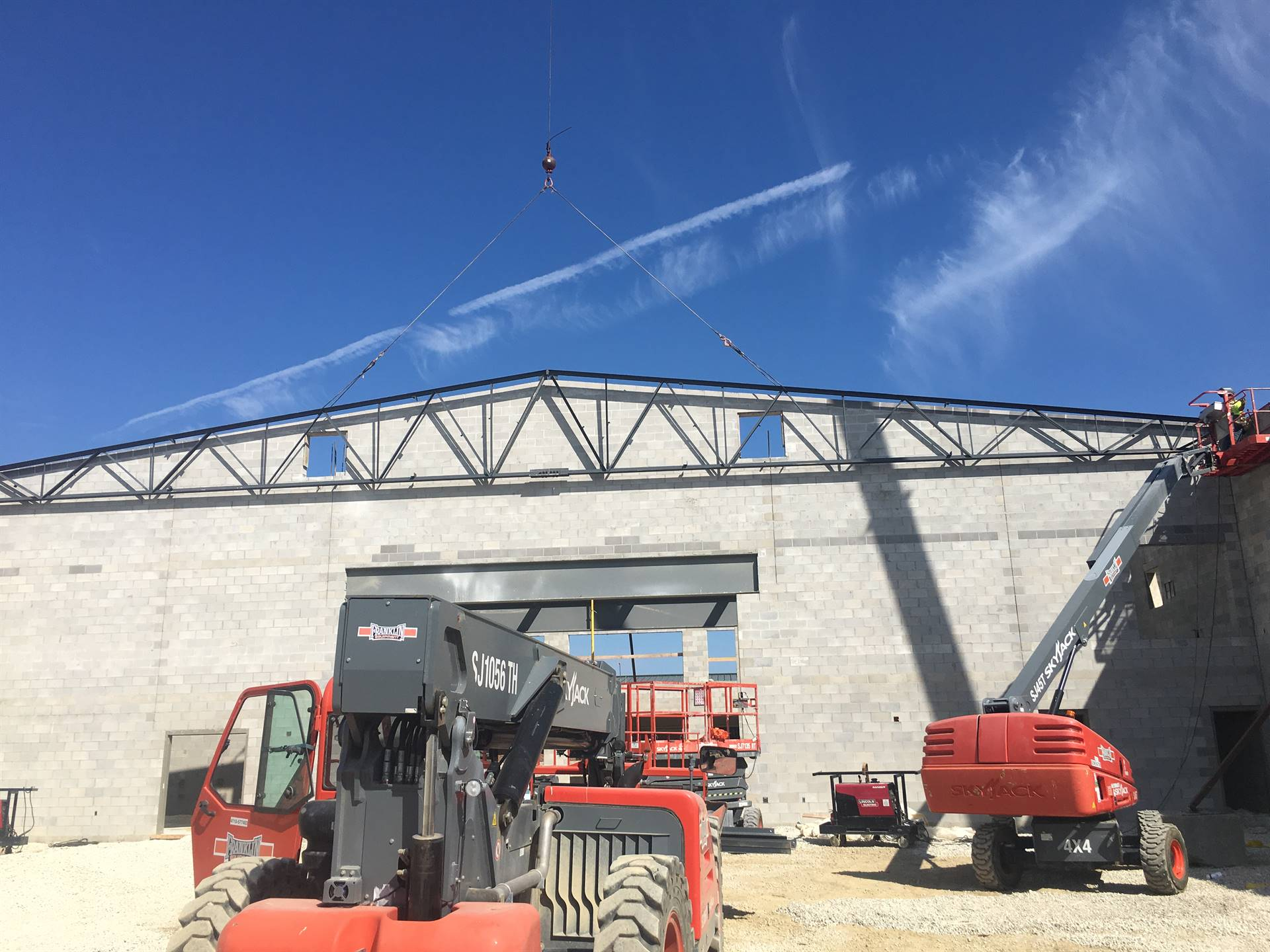 Ground-level photo of steel truss being welded into place