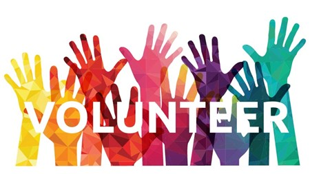 image of colorful hands raised to signify a person's willingness to volunteer